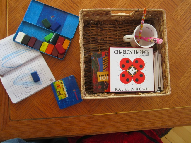 A basket with blank books and note cards along with colored pencils and crayons keep our youngest Sprout busy most mornings.  The Charlie Harper and Andy Warhol stationary boxes are great for storage!