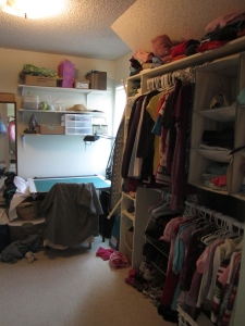 our temporary family closet, complete with sewing table!