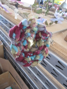 Double finger knitted flowers, coffee filter butterflies, and sticks became...