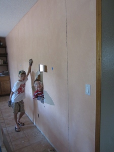 """The boys were delighted to help with the demolition of  """"the wall""""."""