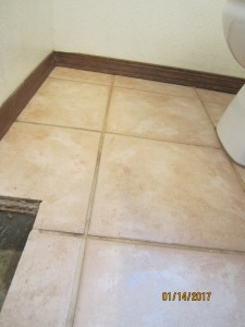 the powder room floor before Grout Renew