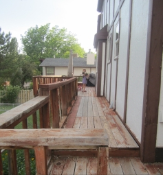 the back deck currently consists of warped Redwood and is sloping downward from the house